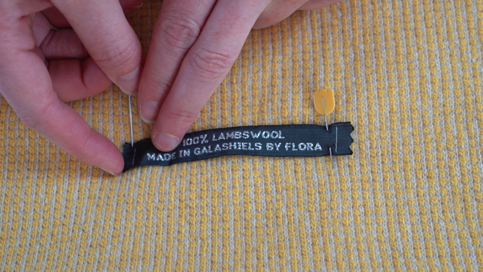 stitching labels to knitwear